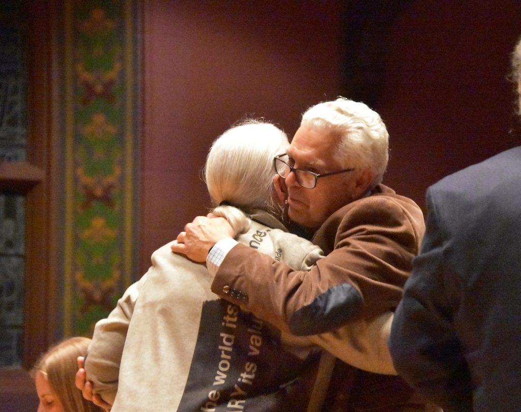 Terry Tempest Williams embraces xxxx Antonio Machado-Allison.